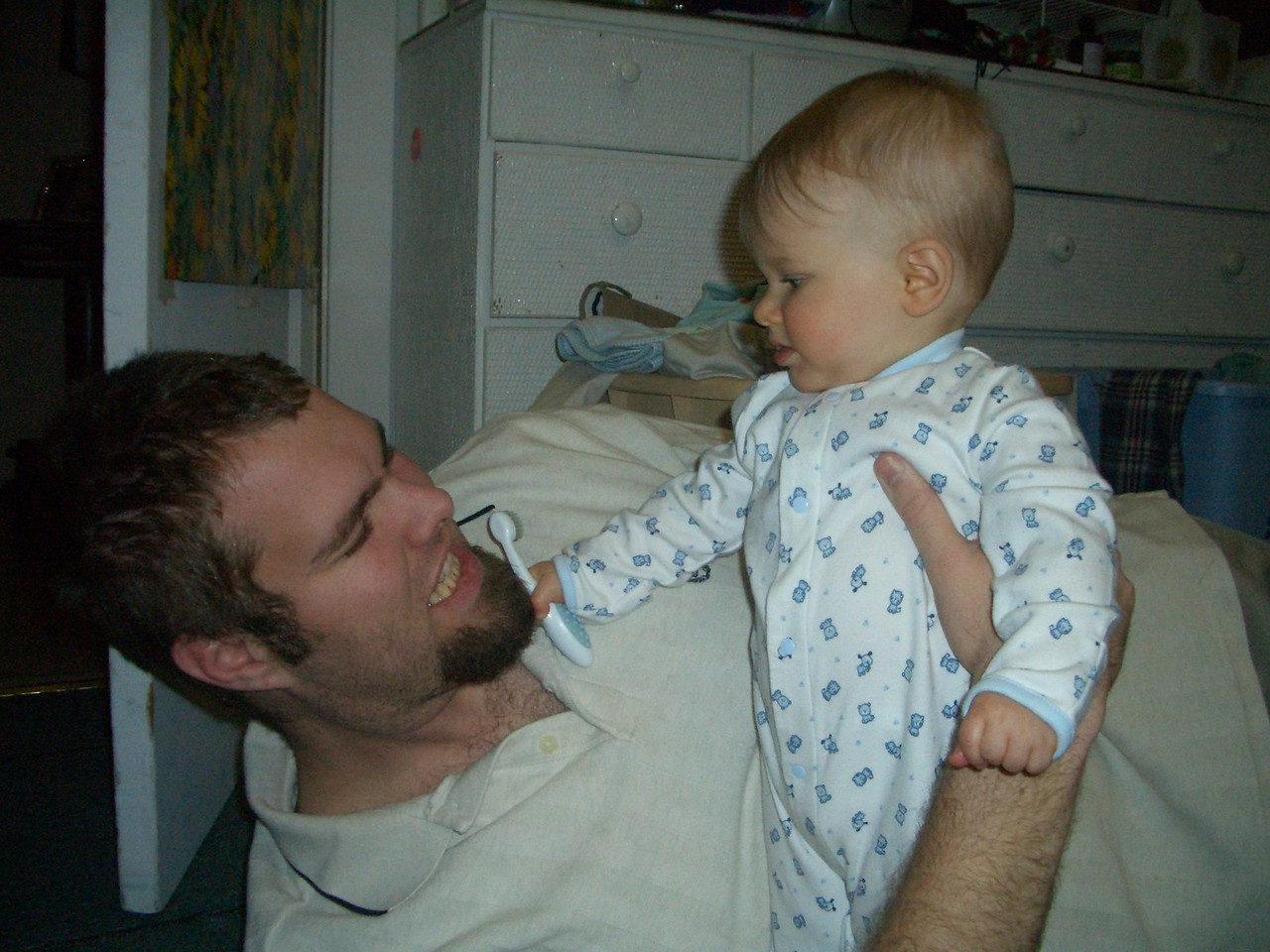 Brushing daddy's teeth. 1/9/07