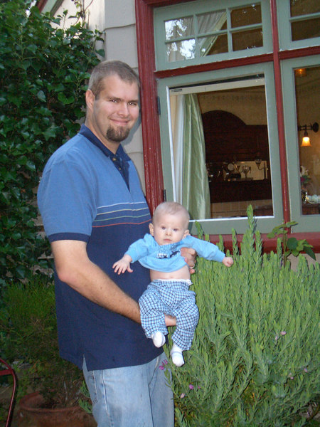 Daddy and Cody standing in front of the widow of our room at the bed and breakfast.