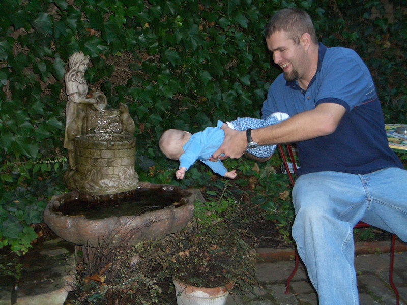 """Daddy playing """"lets stick the baby in the water""""."""