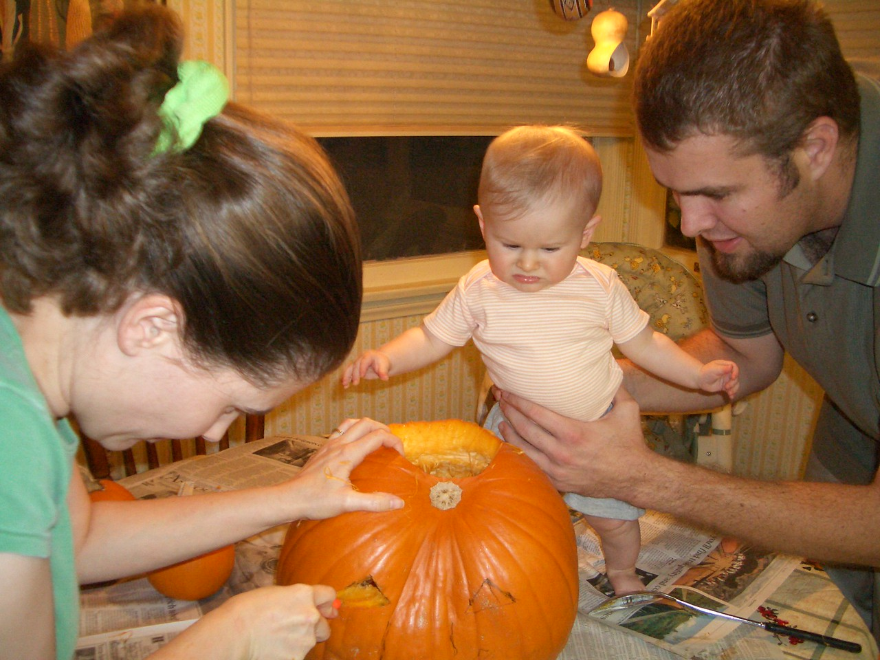 Cody is not too sure what to think about this pumpkin carving stuff.