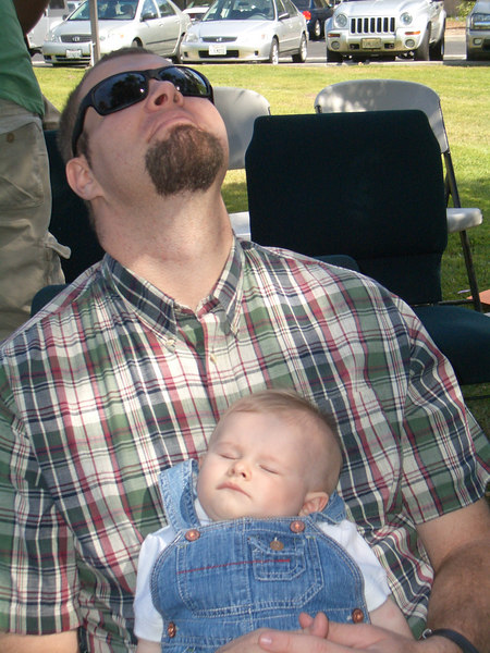 Dad takes a rest while Cody sleeps.