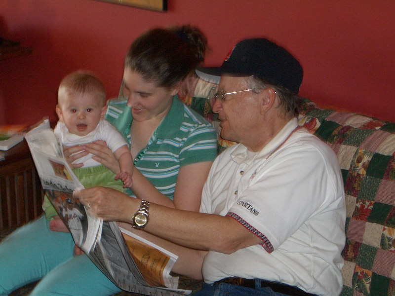 Reading the newspaper is fun when mommy and Grandpa Soctt are there. 10/6