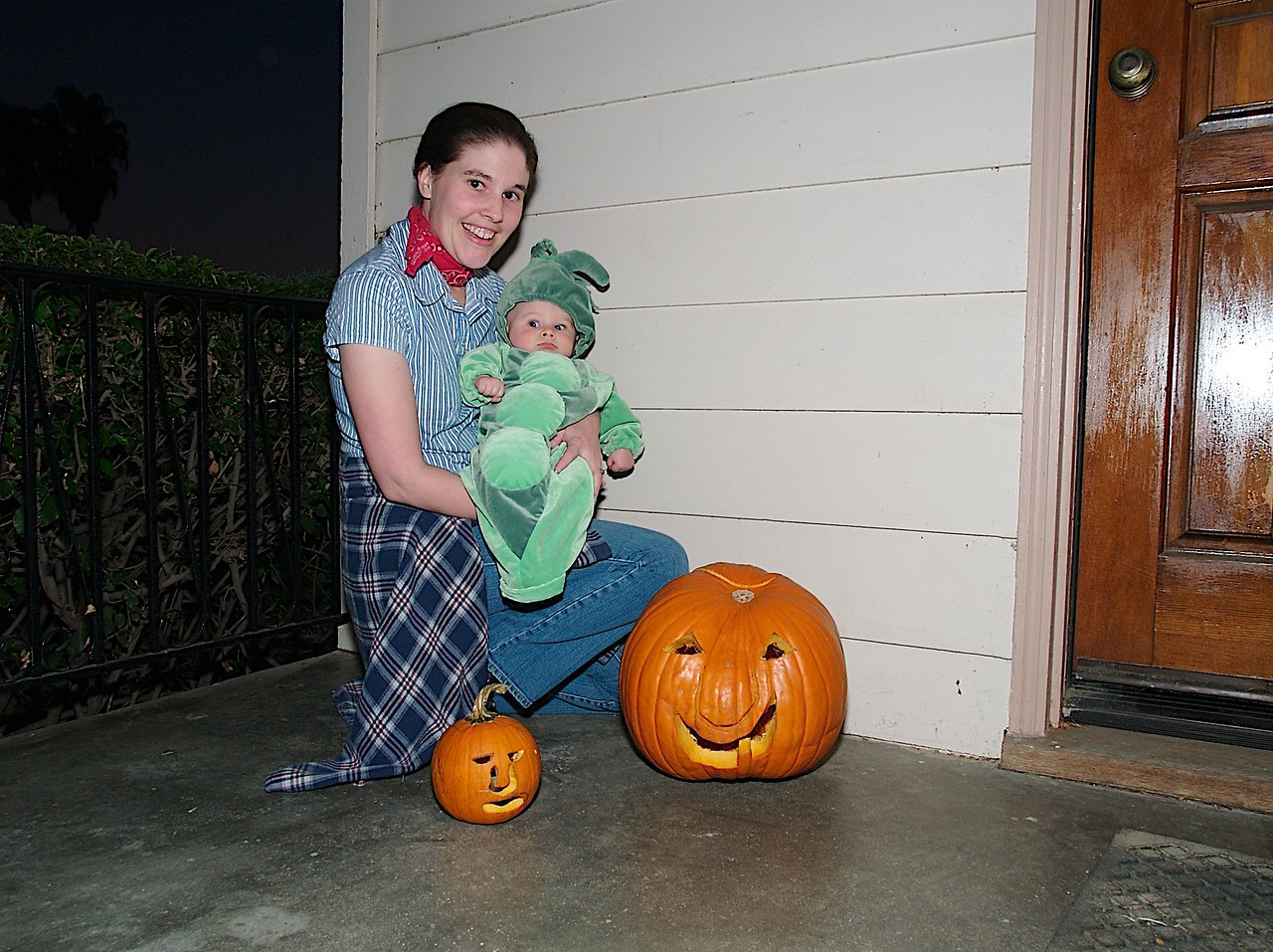 Cody and mommy by the Jack o'Lanterns. 10/31