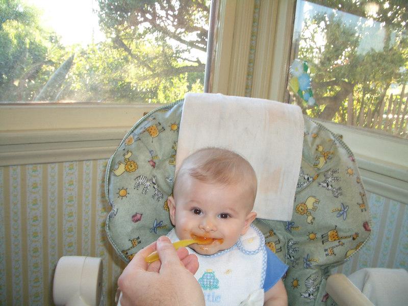 Daddy is feeding me carrots. Yum! 10/4