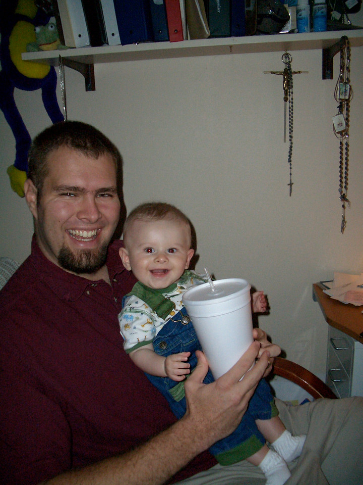 Daddy and Cody with daddy's cup. 10/1 (My 2 little bald boys)
