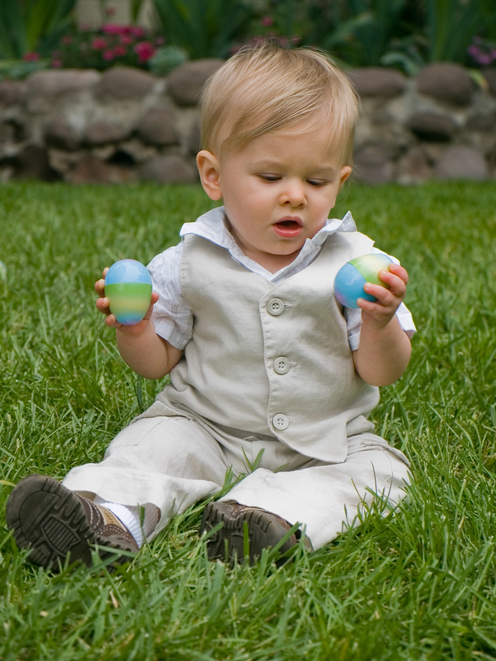 Sitting on the grass with his eggs.