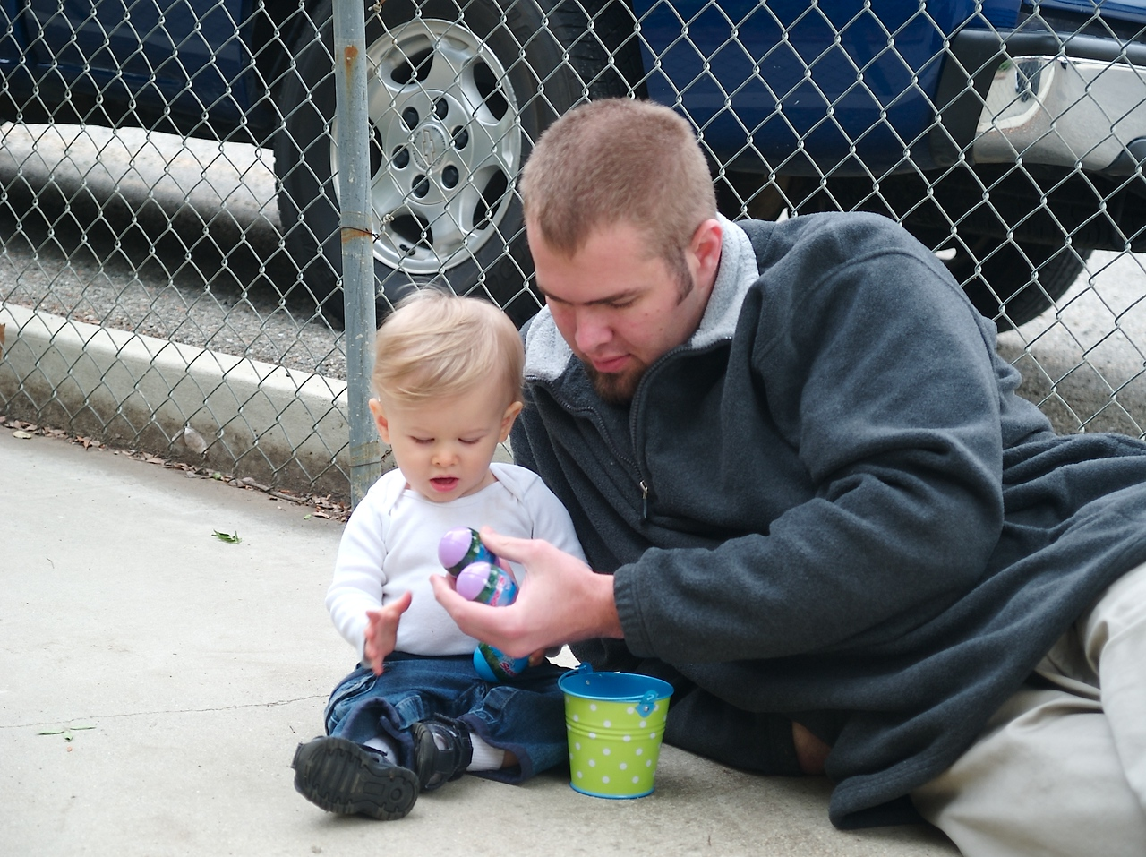 Daddy and Cody playing with the eggs.