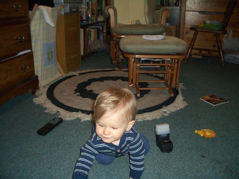 Cody was pushing around daddy's flash like a car. 4/19