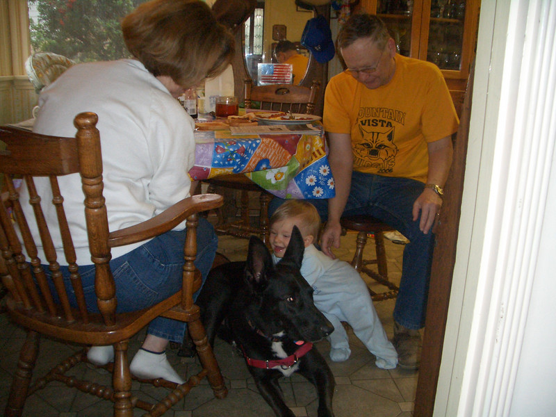 Aphytis let Cody crawl on him. Grandma and grandpa watch Cody to make sure Aphytis does not get hurt. 4/7