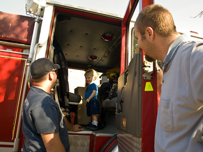 Cody inside the fire truck! Way cool!