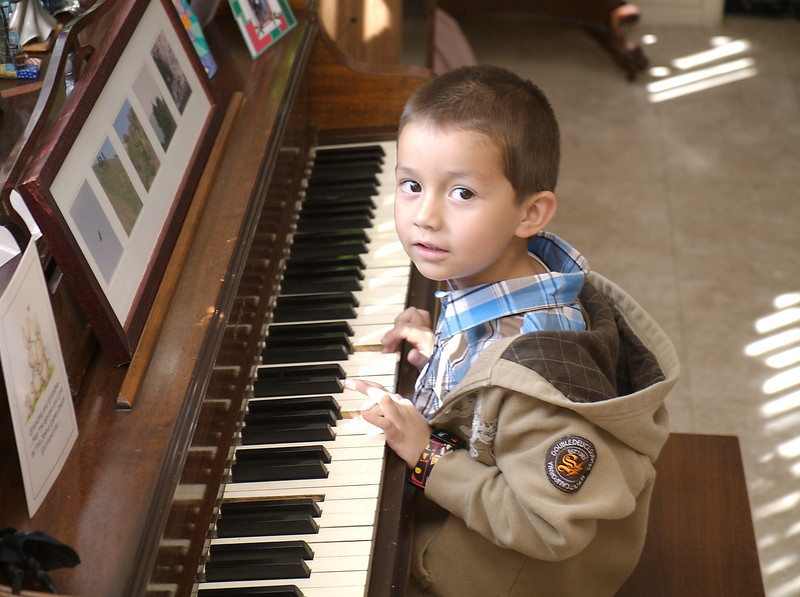 Cousin Bryce playing the piano.