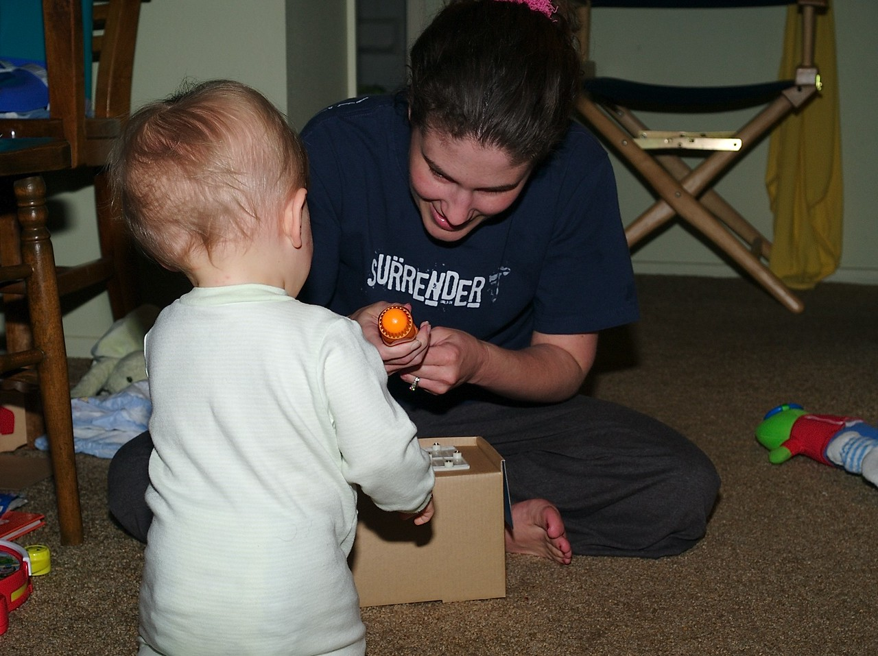 Mommy has to use a screwdriver to get the ambulance out of the box.