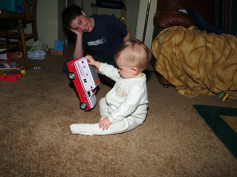 Examining the toy.