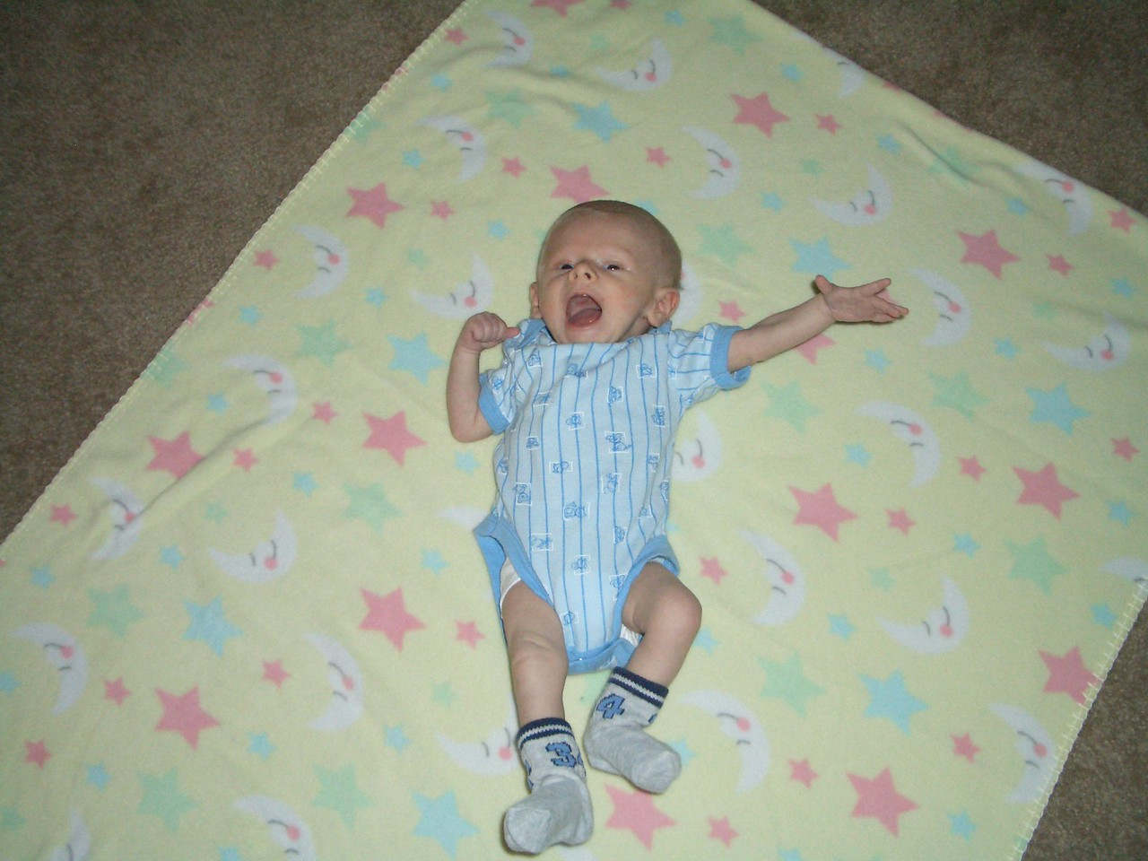 Cody loves the floor because he can kick and wave his arms