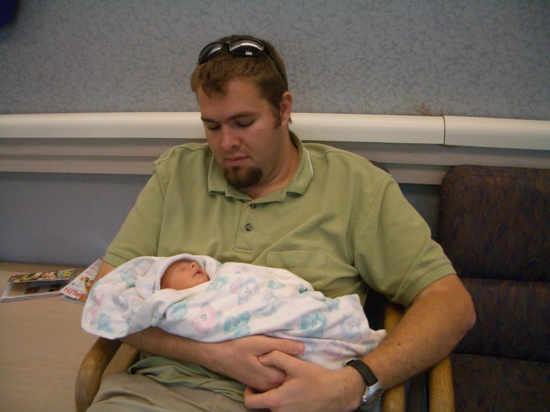 Dad holds Cody as we wait for his first Doctor's appointment 4/7/06