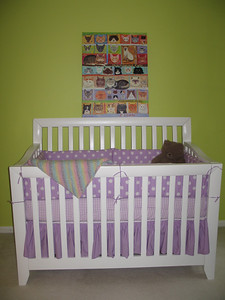 The grandma's and aunt Amy were busy preparing the nursery.