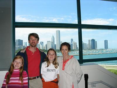 The Carroll Family at the Shedd  Madeleine, Brian, Natalie, Karen, the Chicago Skyline