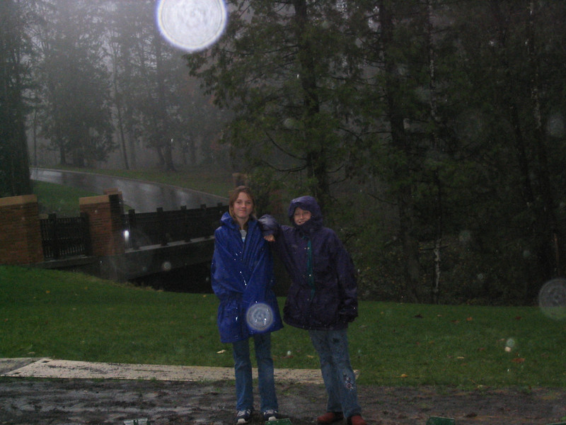 Spirit bubbles <br /> At dads gravesite, Natalie and Madeline pose in the rain