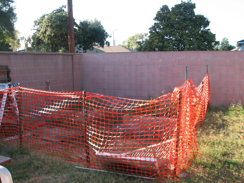 Lovely fence, eh? We can't yet afford a nice vinyl fence and gate, but we have to keep the dog out.
