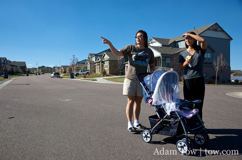 May points to houses around her neighborhood as Abby and Rae look on.