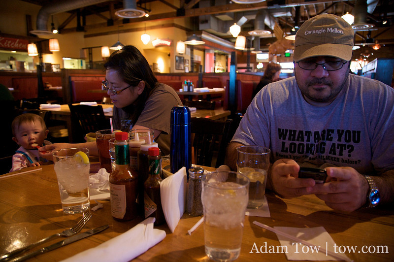 Abby eats, May feeds, and Salim emails at Jim and Nick's BBQ Restaurant in Aurora, Colorado.