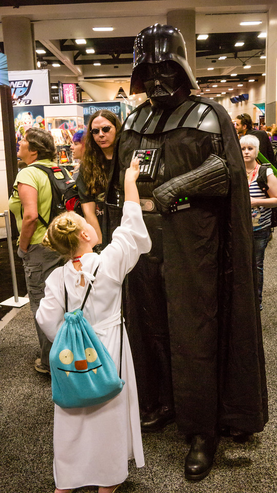Life is stranger... You can't make this kind of stuff up.  A little girl dressed as Princess Leia walked up to a Darth Vader and started playing with his buttons.