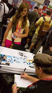Super Syd One of the Comic-Con artists makes a sketch of Sydney as a flying superhero.