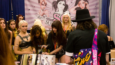 Suicide Girls A collection of girls that get tattoos, take off their clothes, and pose for photos.  Of course, they have a booth at Comic-con.
