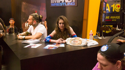What's up? Zombie Wrestling Woman signing autographs…of course.