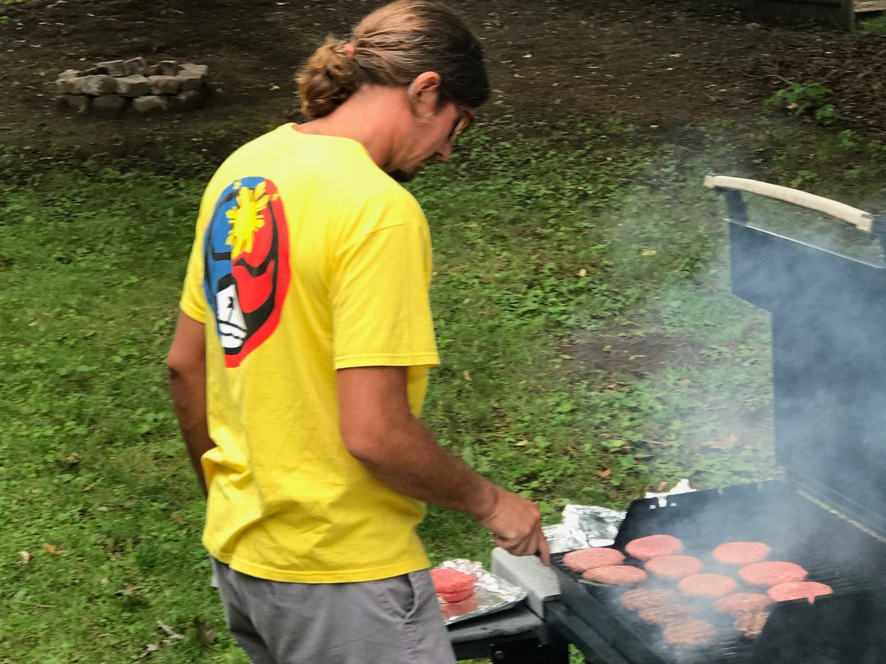 Robbie cooking the burgers