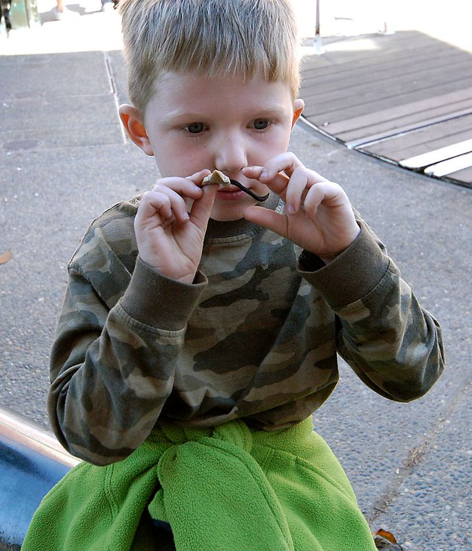 6-29-2005 -- Connor admiring his shark tooth.