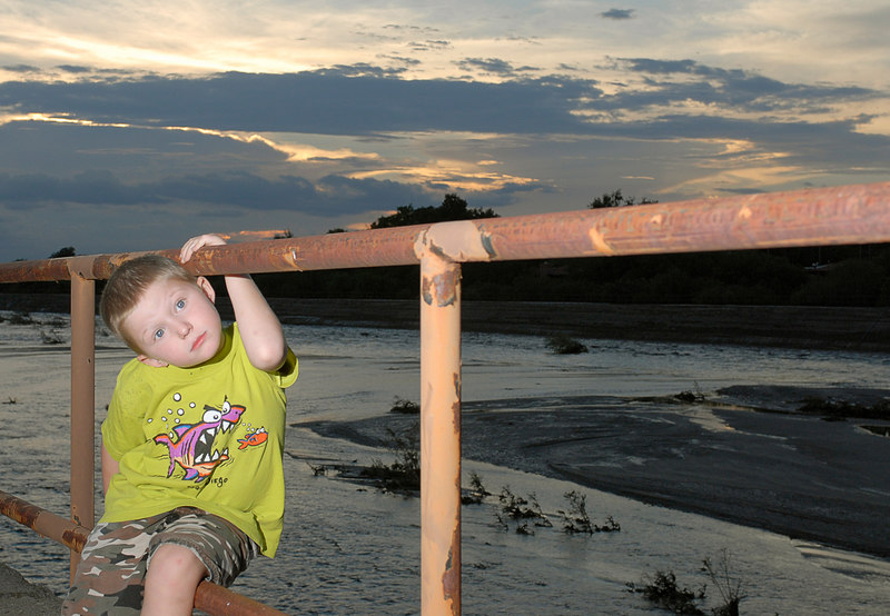 (7.31.2006)  Connor at the flooded Tanque Verde Wash at the Sabino Canyon bridge.