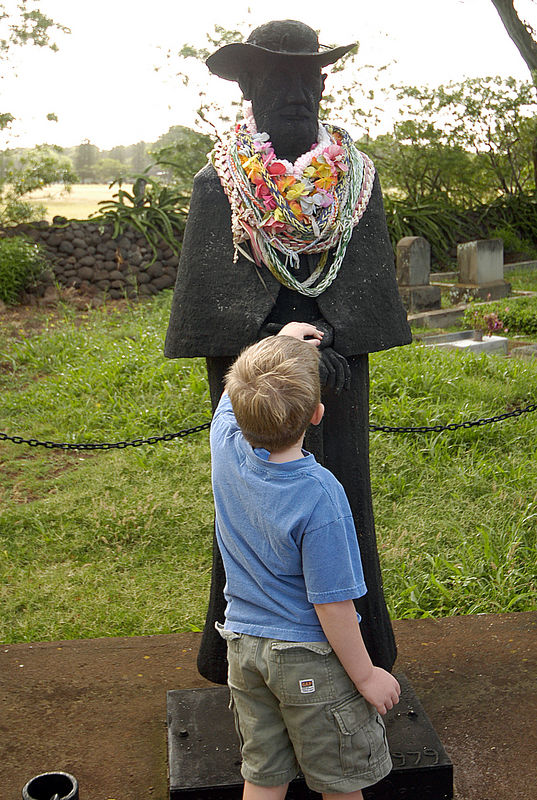 (11-09-2005)  Connor admiring the statue of Father Damien at Our Lady of Seven Sorrows Church on Molokai.