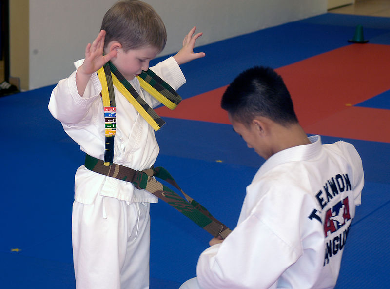 (12.21.2005)  Connor receiving his full camo belt after successfully completing his test.