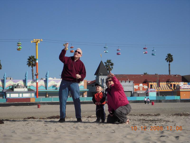 Flying a kite with Grandma Mary and Grandpa Ken in Santa Cruz in 10.08