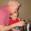 Grandpa Ken and Cooper make oatmeal raisin cookies....Cooper's objective:  eat as many raisins as possibly allowed.