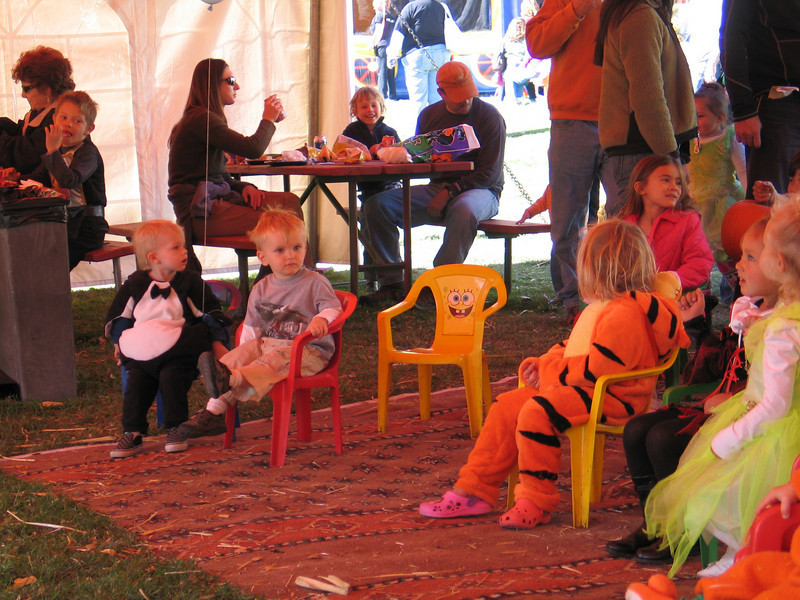 "Cooper listening to kid songs outside Durango at the ""Great Pumpkin Ride""....he tried sitting in each empty chair and then lined them up like a ""choo choo"" train. 10/08."