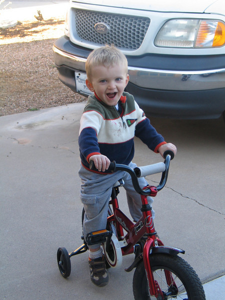 Very excited about his new bike...only hasn't figured out the pedals yet...oh and his head has outgrown the toddler helmut - he now needs a 5+ size helmut.