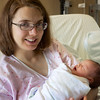 Cora at 21 hours old, with Linnea