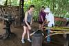 Pounding sugar cane before pressing it
