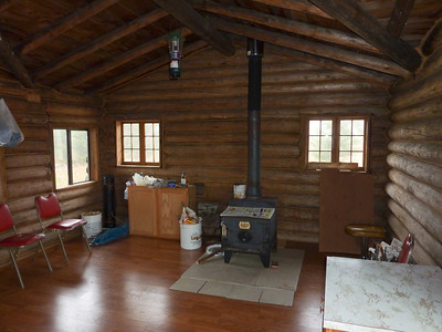 The cabin at the top is nicely arranged with a definitely working stove.