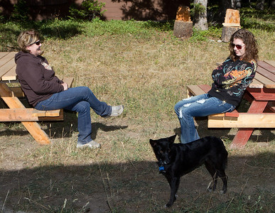 Up on Wineglass Mountain, Karen and Lisa relax with their dog.