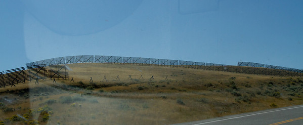 Snow fences were more visible in the exposed rolling hills between the mountain ranges.