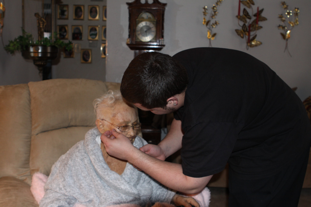 Jeffery taking care of his Grandma