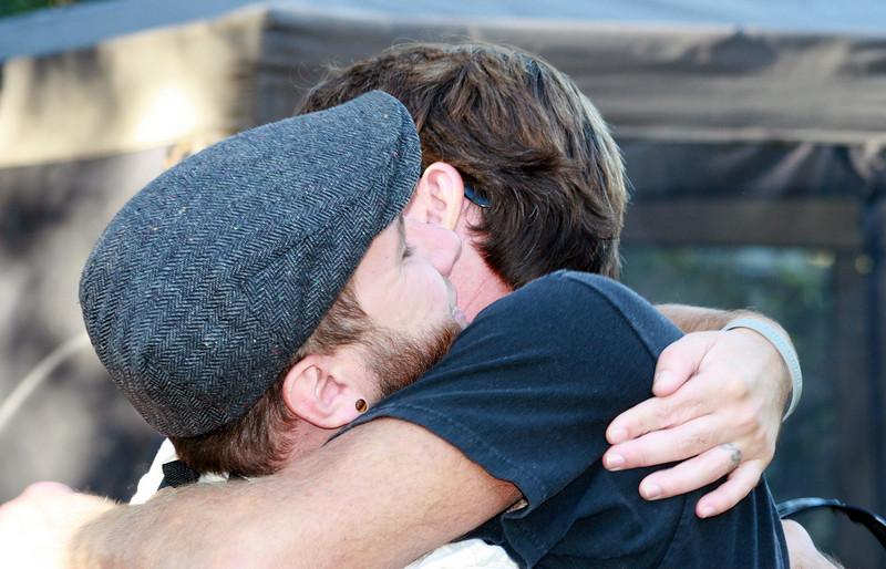 Nick and Steve embrace