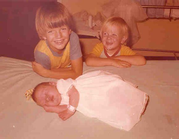 Kirsten aged 7 days - leaving hospital with 2 adoring big brothers - Mackay - 24.11.77