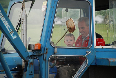 Craig on the tractor with Papa. June 2008.