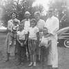 Carole holding Janet, Camille, Kathryn, Harold, George, Sharon, Stan