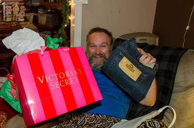 Chris opens his Victoria's Secret bag.