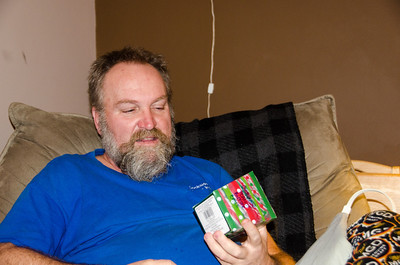 Chris opens his gifts.